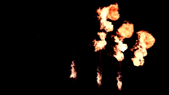 Three Fire Throwers Slow Motion Three Fire Throwers with a Different Angle of Emission in Slow Motion on Black Background architectural column stock videos & royalty-free footage