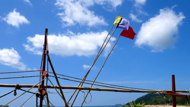 Three Flags on Boat Mast Flapping in the Wind Against Blue Sky video