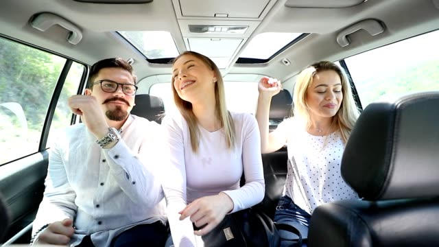 Three friends at back of the car