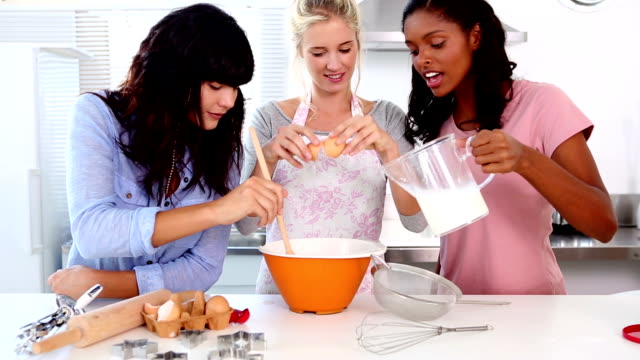 Three friends home baking together video