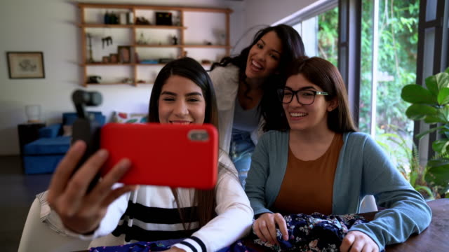 Three friends making a video-selfie together video