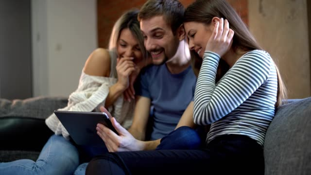 three friends using digital tablet at home - miroslav mitic stock videos and b-roll footage