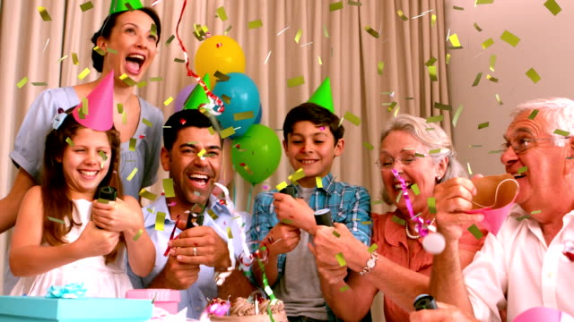 Three generation family celebrating a birthday indoors