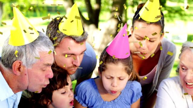 Three generation family celebrating a birthday outdoors