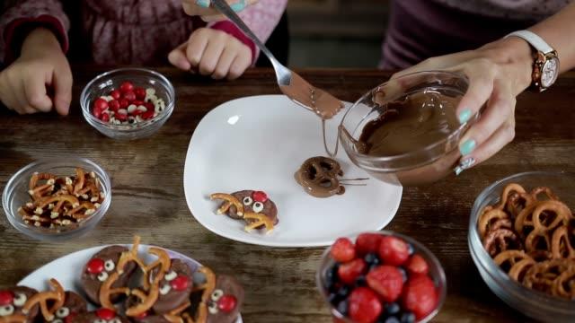 Three generation family making chocolate cookies video