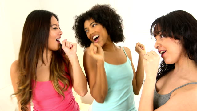 Three girls singing and waving hands video