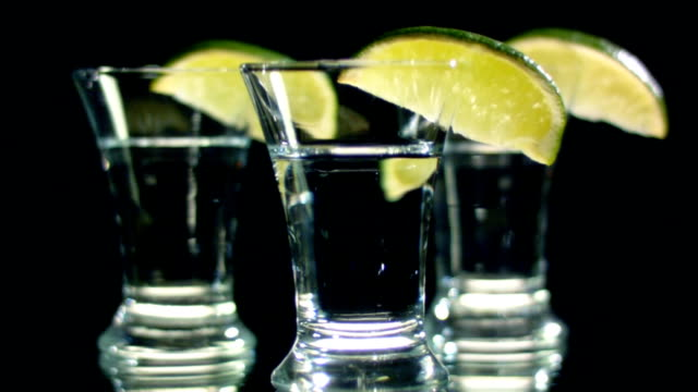 Three glasses of alcohol with lemon Three glasses of alcohol with lemon margarita stock videos & royalty-free footage
