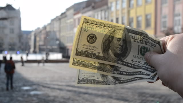 Three hundred dollar bills on blurred background of european old ancient