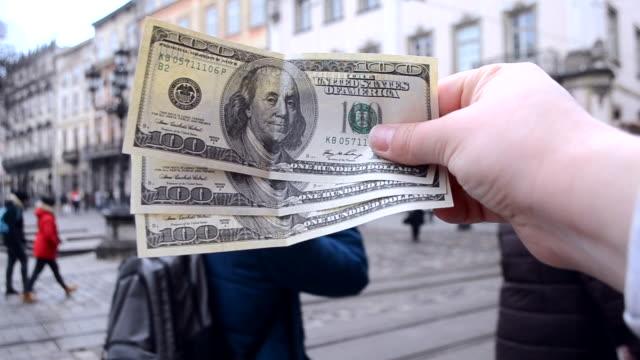 Three hundred dollar bills on blurred background of european