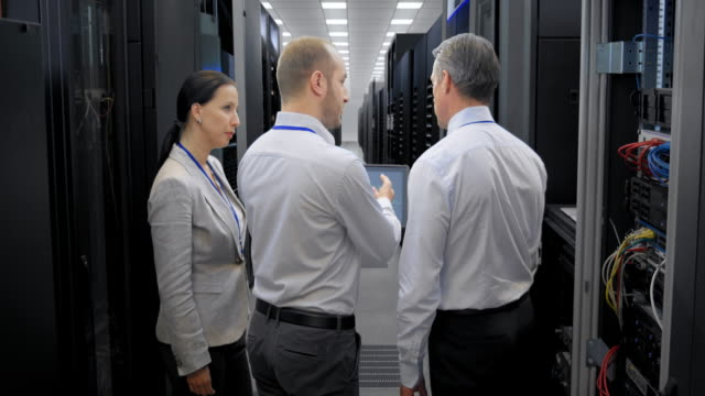 LD Three IT engineers talking in the server room video