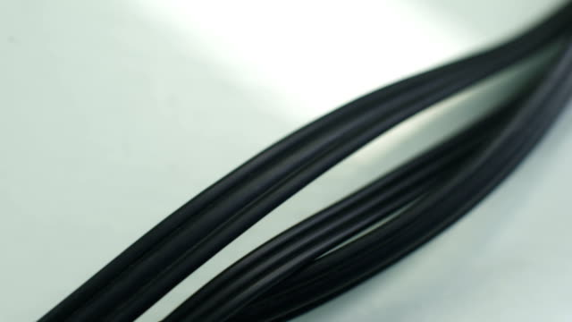 three long black cables connecting video console with tv, rca or phono connector - lungo video stock e b–roll