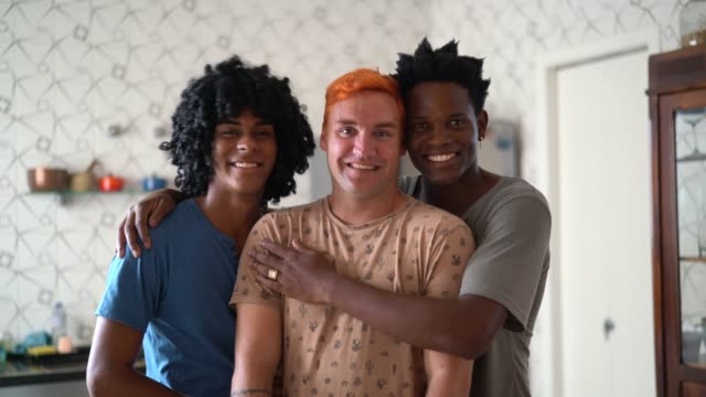 Three lovers / friends portrait at home Modern Gay Family bisexuality stock videos & royalty-free footage