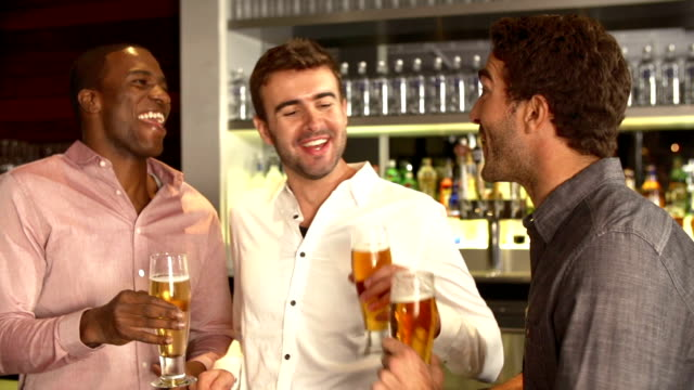 Three Male Friends Enjoying Drink At Bar video