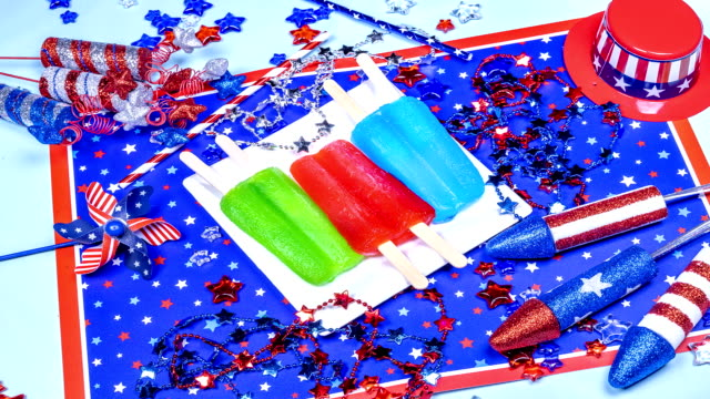 Three melting popsicles on patriotic background video