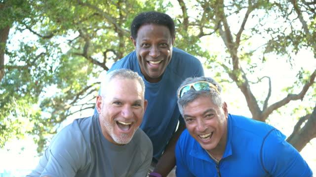 three men done exercising, run up to camera - aktywny tryb życia filmów i materiałów b-roll