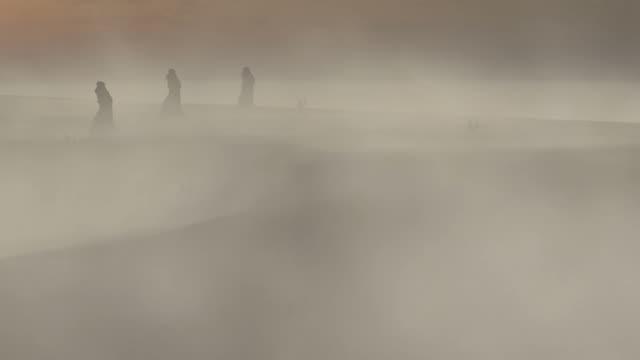 Three Men Walking in Desert Storm (Animation)+ Looping video