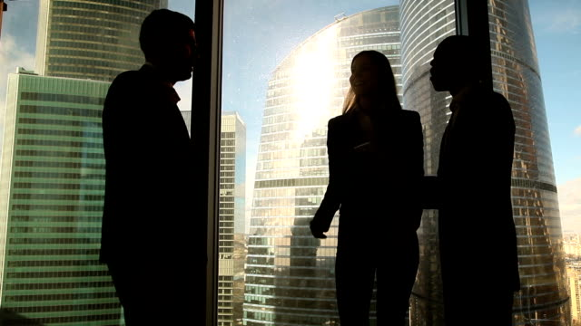 Three multicultural business people starting meeting in office, greeting handshake video