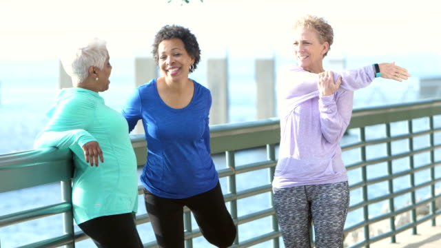 three multi-ethnic mature and senior women exercising - odzież sportowa filmów i materiałów b-roll