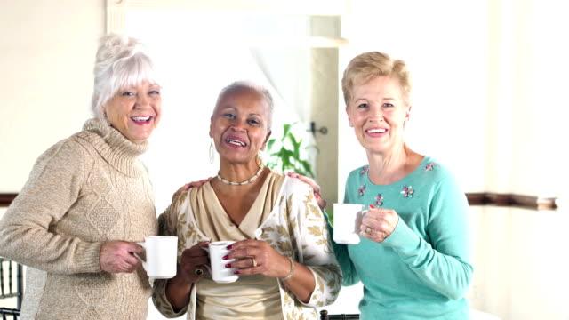 Three multi-ethnic senior women talking to camera video