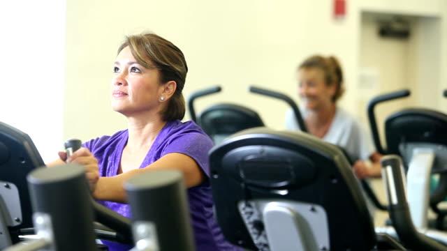 Three multi-ethnic women exercising in gym video