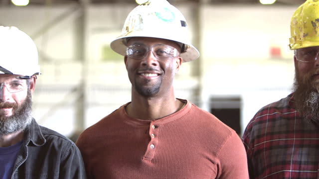 Three multi-ethnic workers wearing hardhats video