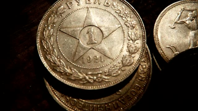 Three Old Soviet Silver Rubles with Symbol Star on Table Hand Rakes Its Super Close Up video