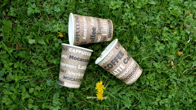 Three paper cups of the coffee on the ground