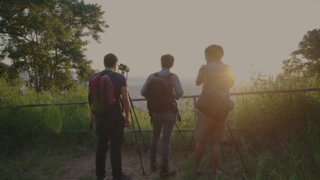 Three Photographer shooting sunrise video time lapse of Chiang Mai city in the morning video