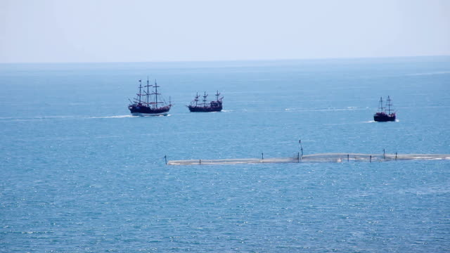 Three pleasure sailing ships in the sea video