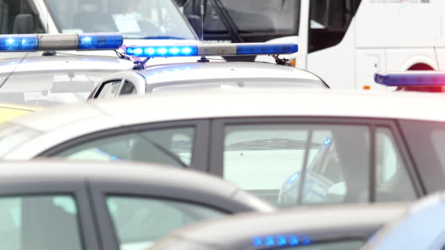 Three police cars on city road - flash lights video