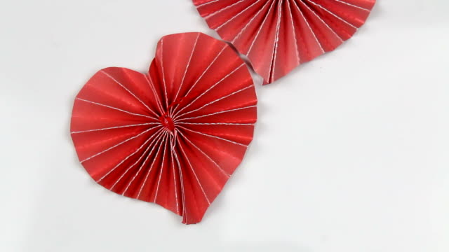 Three red decorating paper hearts