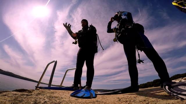 Three Scuba Divers Preparing for Dive video