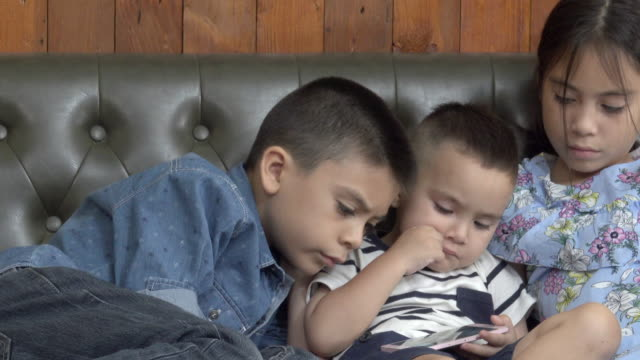 Three Siblings Watching Smart Phone video