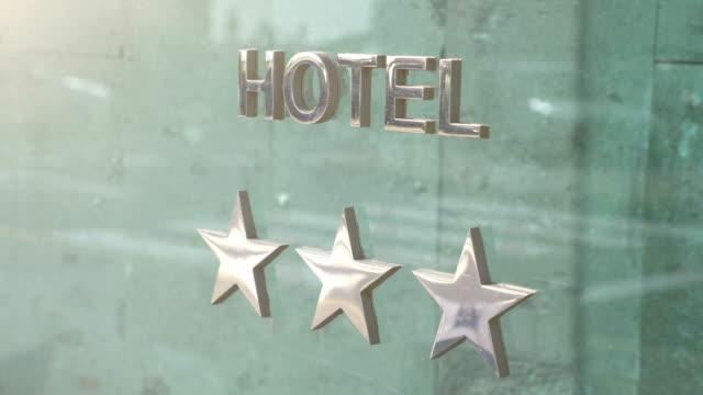 vídeos de stock e filmes b-roll de three stars hotel board in 4k slow motion - três objetos