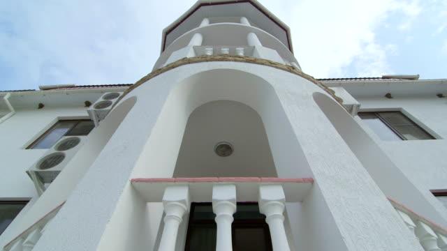 three story mediterranean house with traditional white balustrade balcony - balaustrata video stock e b–roll