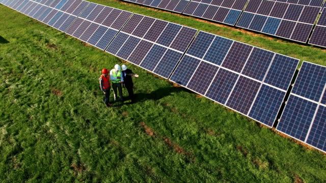 Three technicians at a solar energy farm video