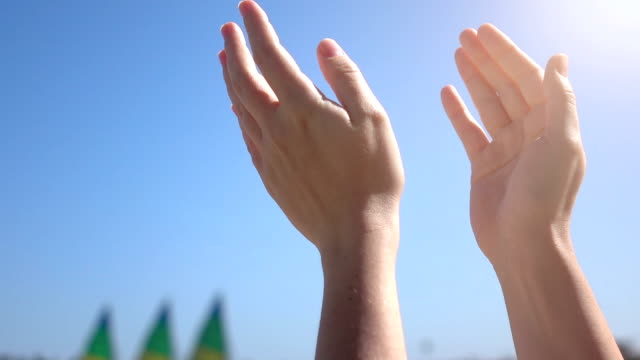 Three videos of clapping hands in real slow motion video