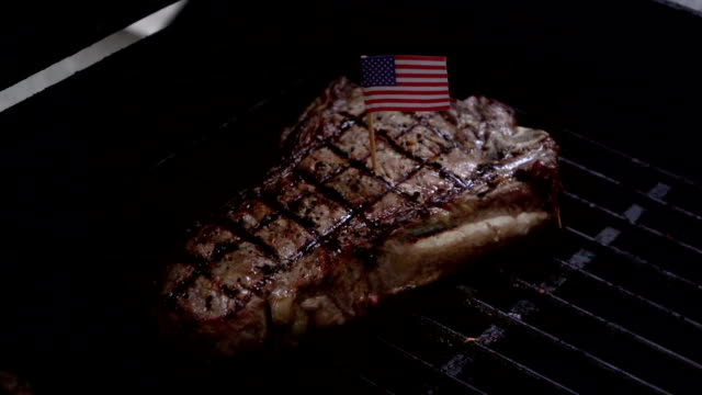 Three videos of cooking american steak on the grill-slow motion video