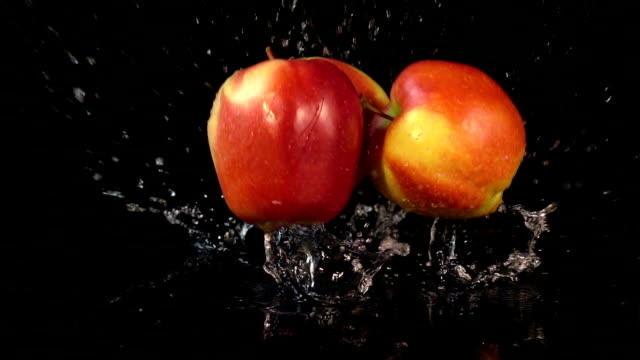 Three videos of falling apples in real slow motion video