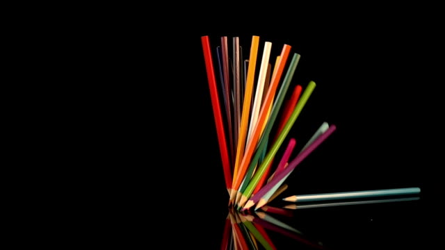 Three videos of falling crayons in real slow motion video