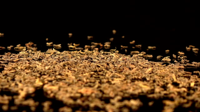 Three videos of falling green tea in real slow motion video