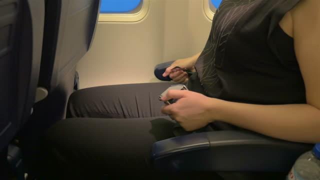 Three videos of fastening seatbelt in 4K video