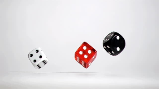 Three white red black dices in slow motion rebonding video