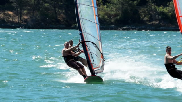 HD: Three windsurfers in the slalom action video