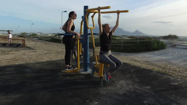 Three young woman exercising together. Three young woman exercising together at an outdoor gym in Cape Town South Africa. table mountain national park stock videos & royalty-free footage