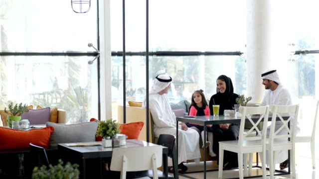 Three-generation Emirati family at cafe video