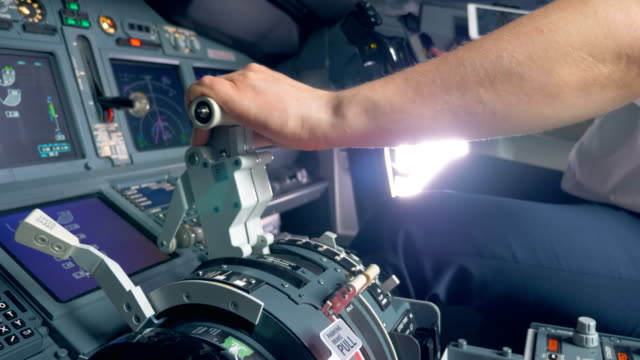 throttle lever is getting pulled by a pilot of an aircraft - pilota video stock e b–roll