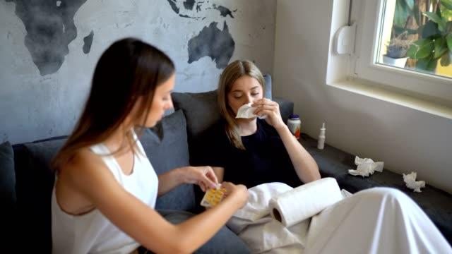 vídeos de stock e filmes b-roll de through sickness with her friend - concrete wall interior