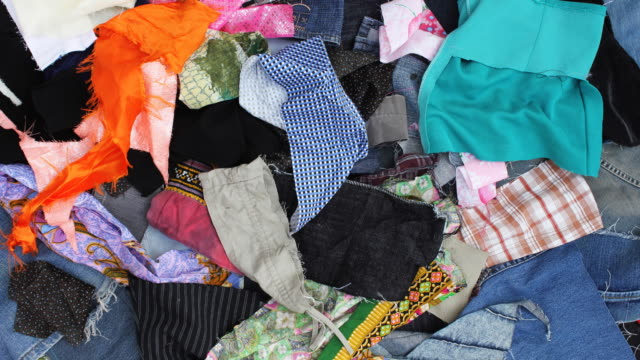 Throw away many pieces of scrap fabric.
