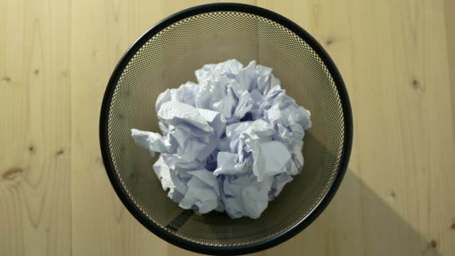 Throw crumpled into the trash. video